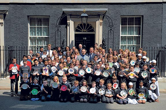 David Walliams and David Cameron and 100 Children at Downing Street the Enough Food For Everyone IF Campaign to end world hunger