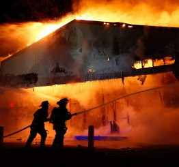 US: Looters set fire to buildings after grand jury decision