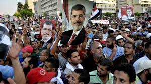 Egyptian court passes out lengthy sentences to Morsi supporters